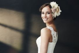 Woman smiling wearing her wedding gown